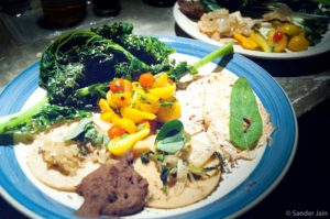 Tortillas with beans, salsa, caramelized onion, sage, steamed kale