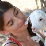 beautiful girl with cute baby goat