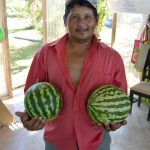 Julio with two watermelons